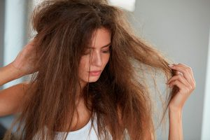 Avoid damage hair by using coconut oil